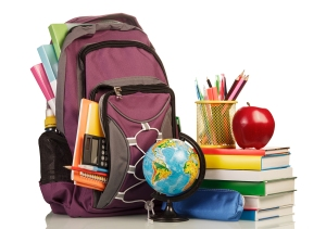 School Backpack with school supplies on white background