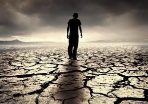 A young man walks into the desolate desert